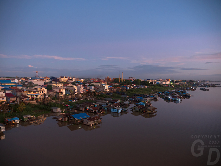 Sunrise and the Bassac River this river is a  distributary of the Tonlé Sap and Mekong River River from a Bridge in Phnom Penh, Vietnamese floating village,Boat people,Cambodia