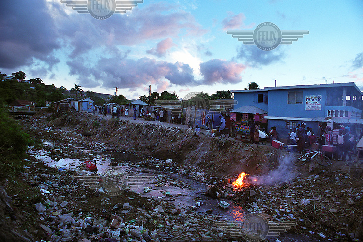 Badly polluted river, filled with dumped garbage.