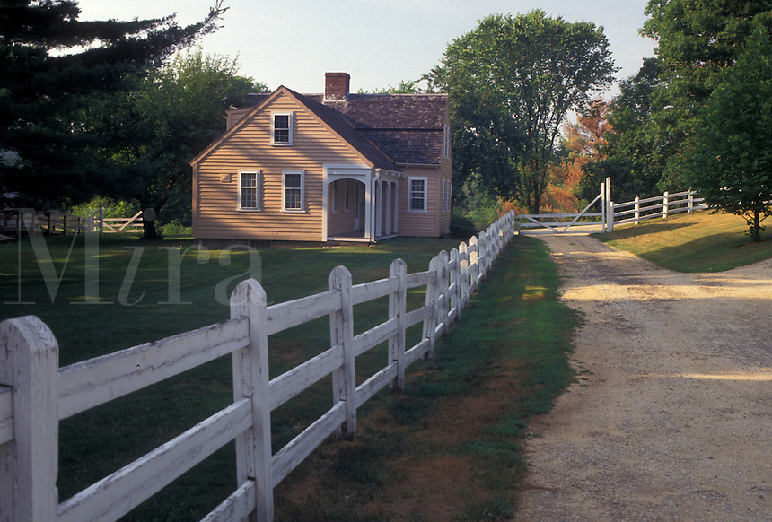 AJ4425, Old Strubridge Village, Massachusetts, A white fence along a dirt path leading to a restored home in Old Sturbridge Village, a living-history museum, in Sturbridge in the state of Massachusetts.