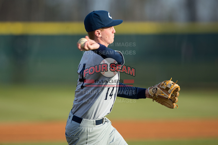 Catawba Indians third baseman Jackson Raper (14) makes a throw to first base during infield practice prior to the game against the Belmont Abbey Crusaders at Abbey Yard on February 7, 2017 in Belmont, North Carolina.  The Crusaders defeated the Indians 12-9.  (Brian Westerholt/Four Seam Images)