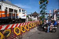 Yogyakarta, Java, Indonesia.  Passenger Train Approaching Main Railroad Station.
