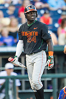 Miami Hurricanes outfielder Jacob Heyward (24) walks back to the dugout after striking out against the Florida Gators in the NCAA College World Series on June 13, 2015 at TD Ameritrade Park in Omaha, Nebraska. Florida defeated Miami 15-3. (Andrew Woolley/Four Seam Images)