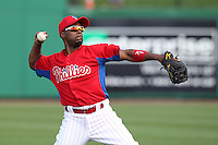 Philadelphia Phillies shortstop Jimmy Rollins #11 throws to first during a scrimmage against the Florida State Seminoles at Brighthouse Field on February 29, 2012 in Clearwater, Florida.  Philadelphia defeated Florida State 6-1.  (Mike Janes/Four Seam Images)