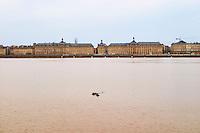 A view across the Garonne of the impressive Place de la Bourse and river side riverside city Bordeaux Gironde Aquitaine France