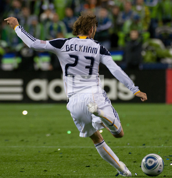 David Beckham (23) of the Los Angeles Galaxy fires a kick on goal in the first game of the 2010 MLS Playoffs at the XBox 360 Pitch at Quest Field in Seattle, WA on October 31, 2010. The Galaxy defeated the Sounders 1-0.