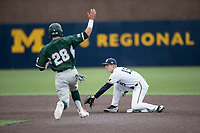 Michigan Wolverines second baseman Jimmy Kerr (15) waits for a throw as Michigan State Spartans baserunner Matt Byars (28) slides on May 19, 2017 at Ray Fisher Stadium in Ann Arbor, Michigan. Michigan defeated Michigan State 11-6. (Andrew Woolley/Four Seam Images)