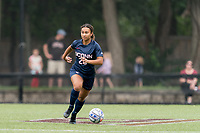 NEWTON, MA - AUGUST 29: Yasmin Rosewell #28 of University of Connecticut brings the ball forward during a game between University of Connecticut and Boston College at Newton Campus Soccer Field on August 29, 2021 in Newton, Massachusetts.