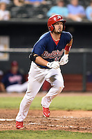 Memphis Redbirds first baseman Scott Moore (12) runs to first during a game against the Oklahoma City RedHawks on May 23, 2014 at AutoZone Park in Memphis, Tennessee.  Oklahoma City defeated Memphis 12-10.  (Mike Janes/Four Seam Images)