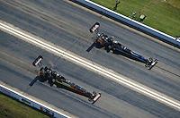 Apr. 28, 2012; Baytown, TX, USA: Aerial view of NHRA top fuel dragster driver Doug Kalitta (near lane) races alongside David Grubnic during qualifying for the Spring Nationals at Royal Purple Raceway. Mandatory Credit: Mark J. Rebilas-