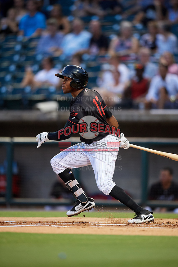 Birmingham Barons center fielder Luis Alexander Basabe (12) follows through on a swing during a game against the Tennessee Smokies on August 16, 2018 at Regions FIeld in Birmingham, Alabama.  Tennessee defeated Birmingham 11-1.  (Mike Janes/Four Seam Images)
