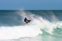 A bodyboarder launches an air reverse spin at Ehukai Beach Park on Oahu's North Shore.