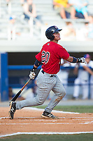Rainis Silva (20) of the Elizabethton Twins follows through on his swing against the Kingsport Mets at Hunter Wright Stadium on July 9, 2015 in Kingsport, Tennessee.  The Twins defeated the Mets 9-7 in 11 innings. (Brian Westerholt/Four Seam Images)