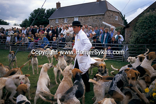 Puppy show held annually during the summer. Quantock Staghounds Somerset and Exmoor 1990s Uk. Hunt servant in bowler hat and white coat 1997. UK