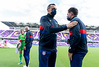 ORLANDO, FL - FEBRUARY 21: Vlatko Andonovski of the USWNT taps the shoulder of Milan Ivanovic before a game between Brazil and USWNT at Exploria Stadium on February 21, 2021 in Orlando, Florida.