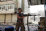 A Free Syria Army soldier fires his weapon against regime forces during intense clashes in the al-Qoob district of Aleppo on Wednesday afternoon...© Javier Manzano