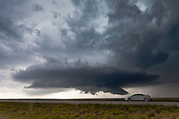Severe thunderstorm behind a car on the side of the road in Wyoming, June 7, 2012