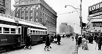 1965 FILE PHOTO - <br /> <br />  the north-east corner of Bloor and Yonge Sts. It shows a street car passing the old Royal building.  Now :  The street car is gone and the bank is part of the towering Bay building