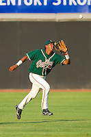 Center fielder Jose Duarte #15 of the Greensboro Grasshoppers makes a running catch against the Hickory Crawdads at  L.P. Frans Stadium July 10, 2010, in Hickory, North Carolina.  Photo by Brian Westerholt / Four Seam Images