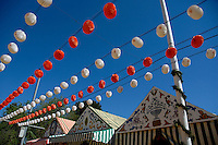Rows of hanging paper lanterns during the Feria de Abril in the Los Remedios district, Seville, Andalusia, Spain.