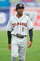 Gregory Lorenzo (1) of the Delmarva Shorebirds warms up in the outfield prior to the game against the Hagerstown Suns at Municipal Stadium on April 11, 2013 in Hagerstown, Maryland.  The Shorebirds defeated the Suns 7-4 in 10 innings.  (Brian Westerholt/Four Seam Images)