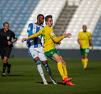 12th September 2020 The John Smiths Stadium, Huddersfield, Yorkshire, England; English Championship Football, Huddersfield Town versus Norwich City;  Adama Diakhaby of Huddersfield Town and  Kenny McLean of Norwich City  contest for the ball
