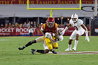 LOS ANGELES, CA - SEPTEMBER 11: Kyu Blu Kelly #17 of the Stanford Cardinal tackles Gary Bryant Jr. #1 of the USC Trojans during a game between University of Southern California and Stanford Football at Los Angeles Memorial Coliseum on September 11, 2021 in Los Angeles, California.