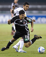 US Open Cup Quarter Final United's Alecko Eskandarian (11) is fouled by Red Bulls' Amado Guevara (20) during the game. DC United defeated New York Red Bulls 3-1, Wednesday, August 23, 2006 at RFK Stadium.