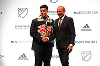 Philadelphia, PA - Thursday January 19, 2018: Brian White, Don Garber during the 2018 MLS SuperDraft at the Pennsylvania Convention Center.