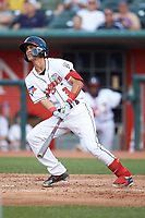 Kevin Vicuna (3) of the Lansing Lugnuts follows through on his swing against the South Bend Cubs at Cooley Law School Stadium on June 15, 2018 in Lansing, Michigan. The Lugnuts defeated the Cubs 6-4.  (Brian Westerholt/Four Seam Images)