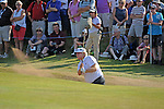 Last years winner Mark Wiebe gets his ball out of the bunker on the 13th  green during day one of The Senior Open Golf Tournament at The Royal Porthcawl Golf Club in South Wales this afternoon.