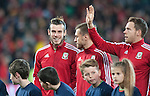 UEFA EURO 2016 Qualifier match between Wales and Andorra at Cardiff City Stadium in Cardiff : Wales football team players Gareth Bale, Aaron Ramsey and Chris Gunter line up for the national anthems ahead of kick off.