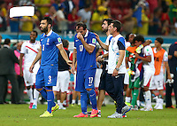 An emotional Theofanis Gekas of Greece at full time after he missed the vital penalty as his side lost to Costa Rica 5-3 in the shootout