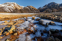 Spring Landscape of frozen gypsum creek with Sheep Mountain and the snow-covered Chugach Mountains in theTahneta Pass / Glacier-View area of Southcentral, Alaska <br /> <br /> Photo by Jeff Schultz/  (C) 2020  ALL RIGHTS RESERVED