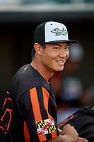 Aberdeen IronBirds Guiyuan Xu (26) in the dugout before a game against the Staten Island Yankees on August 23, 2018 at Leidos Field at Ripken Stadium in Aberdeen, Maryland.  Aberdeen defeated Staten Island 6-2.  (Mike Janes/Four Seam Images)