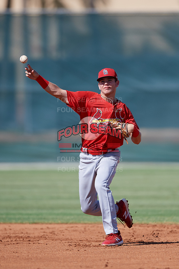 GCL Cardinals shortstop Mateo Gil (16) throws to first base during a game against the GCL Nationals on August 5, 2018 at Roger Dean Chevrolet Stadium in Jupiter, Florida.  GCL Cardinals defeated GCL Nationals 17-7.  (Mike Janes/Four Seam Images)