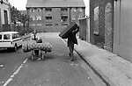 Toxteth Liverpool after riots. July 1981. Couple help themselves to a bed frame and matress from looted store. Toxteth riots 1981