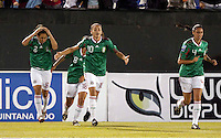 Dinora Garza (C) of Mexico during the semifinal match of CONCACAF Women's World Cup Qualifying tournament held at Estadio Quintana Roo in Cancun, Mexico. Mexico 2, USA 1.