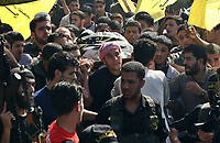 "Palestinian carry the body of member of Sarya Alquds Brigads the wing army for Islamic Jihad Movement  Mahmoud al Haj  in the Nusayrat refugee camp, central Gaza Strip. who was killed by Israel army in westren al Burij Refugee camp 01 November 2007  ""photo by Fady Adwan"""