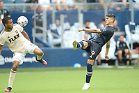 KANSAS CITY, KS - JUNE 26: Alan Pulido #9 Sporting KC shoots on goal during a game between Los Angeles FC and Sporting Kansas City at Children's Mercy Park on June 26, 2021 in Kansas City, Kansas.
