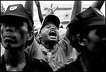Summer '99-- Jakarta, Indonesia -- Golkar rally fans scream for the candidate Akbar Tanjung.