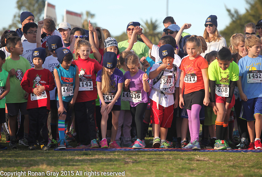 DeAnza Cove, Mission Bay, San Diego CA, USA.  Sunday, January 25 2015:  Participants get ready to start the 1-mile kids run part of the Friends of Pacific Beach Schools (FOPBS) School Yard Dash.  The 2nd annual charity event which raises money for the six local schools in the Mission Bay Cluster, comprised of a 1-mile run for kids followed by a 5K run for all ages.  Besides parents, teachers, staff, students and siblings competitors from all over San Diego and abroad ran in the event.  All six schools in the Mission Bay cluster had information booths at the event for potential parents to meet and speak with staff and students.  Music was provided by local teenage band Rubber Band and the string ensemble from Crown Point Elementary School.