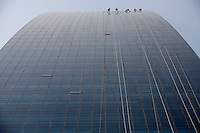 "Window cleaners wash off the dust and dirt accumulated on a newly built skyscraper in Shanghai, China. Enormous brown clouds of pollution hanging over Asia are killing hundreds of thousands of people, melting glaciers, changing weather patterns and damaging crops, the United Nations said recently. Car traffic, factory emissions and indoor cooking are among the culprits for the ""Atmospheric Brown Clouds"", which are up to three kilometres (1.8 miles) thick, according the UN's Environment Programme (UNEP).   .25 Nov 2008"