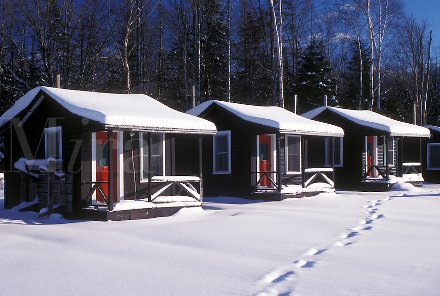 cottages, cabins, NH, New Hampshire, Snow covered cottages in the winter in Twin Mountain.