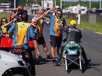Jun 7, 2015; Englishtown, NJ, USA; NHRA pro stock motorcycle rider Jerry Savoie (right) celebrates with his crew after winning the Summernationals at Old Bridge Township Raceway Park. Mandatory Credit: Mark J. Rebilas-
