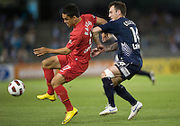 MELBOURNE, AUSTRALIA - OCTOBER 30: Iain Ramsay of United and Billy Celeski of the Victory compete for the ball during the round 12 A-League match between the Melbourne Victory and Adelaide United at Etihad Stadium on October 30, 2010 in Melbourne, Australia.  (Photo by Sydney Low / Asterisk Images)