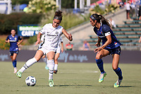 CARY, NC - SEPTEMBER 12: Sophia Smith #9 of the Portland Thorns FC is defended by Abby Erceg #6 of the North Carolina Courage during a game between Portland Thorns FC and North Carolina Courage at Sahlen's Stadium at WakeMed Soccer Park on September 12, 2021 in Cary, North Carolina.