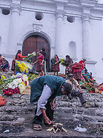 south America, Guatemala. Chichicastenango, maya man prepare fire for celebrations on the steps of the church of Santo Tomás