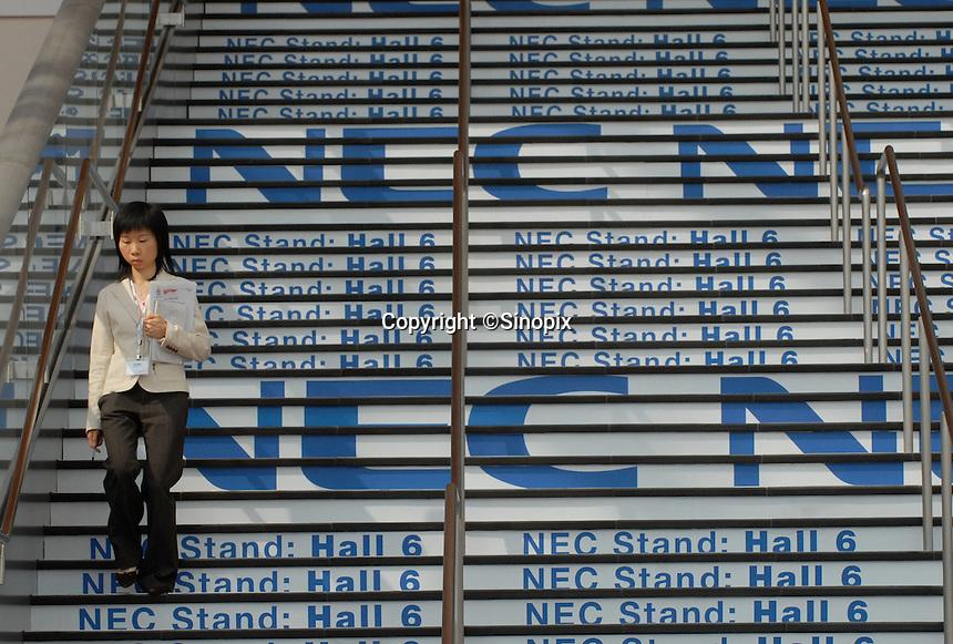 NEC adverts on the stairs at ITU Telecom World 2006 at AsiaWorld-Expo in Hong Kong, China..