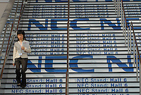 NEC adverts on the stairs at ITU Telecom World 2006 at AsiaWorld-Expo in Hong Kong, China..