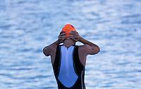 20 JUL 2013 - HAMBURG, GER - Tony Dodds (NZL) of New Zealand prepares for the start of the swim at the elite men's ITU 2013 World Triathlon Series round in the Altstadt Quarter, Hamburg, Germany (PHOTO COPYRIGHT © 2013 NIGEL FARROW, ALL RIGHTS RESERVED)